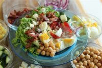 This July 13, 2015, photo, shows late summer cobb salad in Concord, N.H. This Cobb salad has chickpeas and eggs as the main proteins, and the traditional bacon as well, which could be left out for a vegetarian version. (AP Photo/Matthew Mead)
