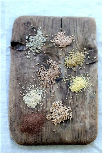 This July 20, 2015 photo shows whole grains, from top left clockwise, rye berries, farro, freekeh, millet, triticale, teff, quinoa, and wheat berries in Concord, NH. Whole grains are gaining ground as more Americans look beyond brown rice. (AP Photo/Matthew Mead)