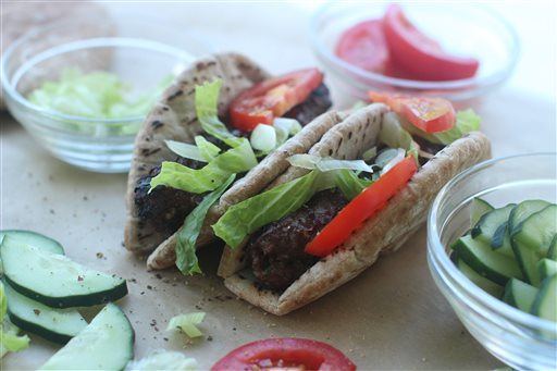 This Aug. 3, 2015 photo shows kebab mashwi in Concord, N.H. This dish is from a recipe by Aarti Sequeira. (AP Photo/Matthew Mead)