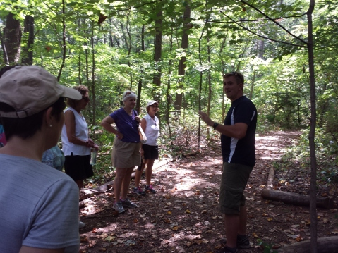Walkers stop during a short hike at the Althouse Arboretum in Upper Pottsgrove to learn some interesting facts about the open space area . Michilea Patterson — The Mercury