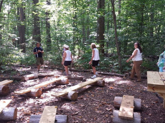 Walkers pass by an outdoor classroom made from wooden structures during a guided hike at Althouse Arboretum in Upper Pottsgrove. The Mercury Mile is doing a three-week walk series at the location. Michilea Patterson — The Mercury