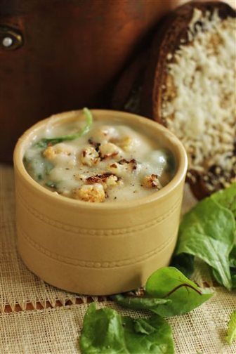 This September 14, 2015 photo shows roasted cauliflower and greens soup with cheesy rye toasts in Concord, NH. The finished product is a tasty, hearty, healthy and affordable soup for supper. And if you use vegetable broth, it's vegetarian, too. (AP Photo/Matthew Mead)