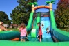 Children enjoy a huge inflatable slide at the 2014 St. Luke's Lutheran Church Community Day. Submitted Photo