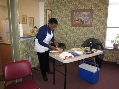 Mandel Smith, a nutrition, diet and health educator for Penn State Extension, demonstrates how to cook a healthy recipe during a free diabetes program at the Limerick Green senior community development in February. Submitted Photo