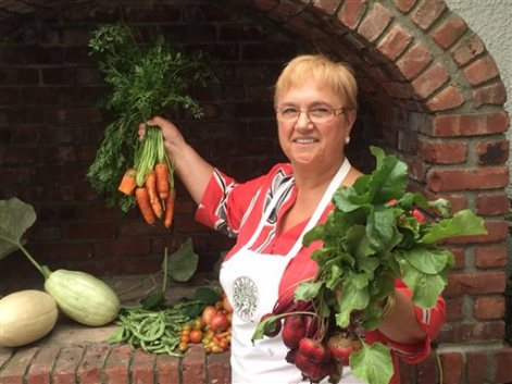 In this Sept . 22, 2015 photo provided by Vladimir Vladimir, chef Lidia Bastianich displays vegetables from her garden, at her home in Douglaston Manor, in the Queens borough of New York. Bastianich, who is cooking for her second pontiff during Pope Francis' New York trip said her menu was inspired by humility and simplicity. (Vladimir Vladimir via AP)