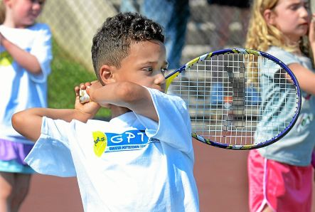 FILE PHOTO — Six-year-old Deven Vennera practices his backhand during a tennis clinic in Pottstown. Tom Kelly III — For Digital First Media