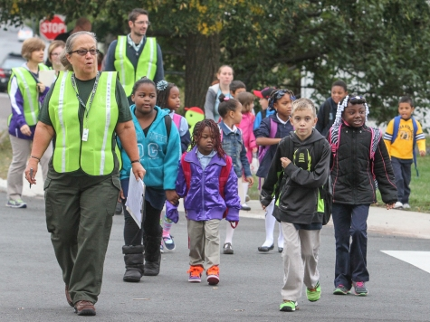 Edie Shean-Hammond, far left, leads a group of Rupert Elementary students as part of the walking school bus on Wednesday morning. Shean-Hammond is one of several adult volunteers who will walk children to school on safe, predetermined routes. KEVIN HOFFMAN — THE MERCURY