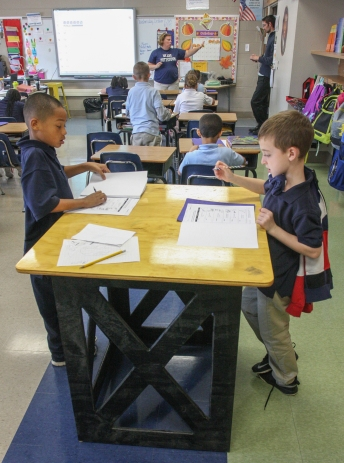 Students from Barth Elementary School in Pottstown complete worksheets while standing at an elevated workstation. All schools in the Pottstown School District use some form of a standing desk.  Kevin Hoffman - The Mercury.