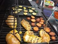 Chicken breasts and vegetables are grilled for free samples during the St. Luke's Community Day in Upper Frederick on Saturday.