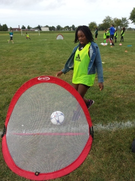 Children involved in a local mentoring program ran drills with the Soccer for Success program as part of a music video about going for the goal.