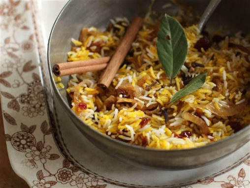 "This September 28, 2015 photo shows berry pilaf in Concord, NH. Author Madhur Jaffrey's newest book, ""Vegetarian India: A Journey Through the Best of Indian Home Cooking,"" will be released in October. (AP Photo/Matthew Mead)"