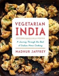 "This image provided by Alfred A. Knopf shows the cover for the book ""Vegetarian India"" by Madhur Jaffrey. Jaffrey's newest book, ""Vegetarian India: A Journey Through the Best of Indian Home Cooking,"" will be released in October. (Alfred A. Knopf via AP)"