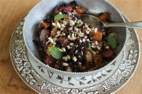 This Sept. 21, 2015 photo shows black rice autumn salad in Concord, NH. Rice salads are the perfect side dish that can be turned into a main meal just by adding some rotisserie chicken, tofu or fish.(AP Photo/Matthew Mead)