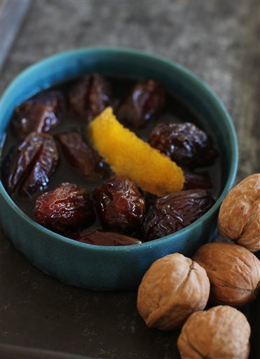 This Oct. 19, 2015, photo, shows Madeira marinated dates in Concord, N.H. Madeira-marinated dates can be used as a deliciously sweet relish or an eat-from-the-jar treat. (AP Photo/Matthew Mead)