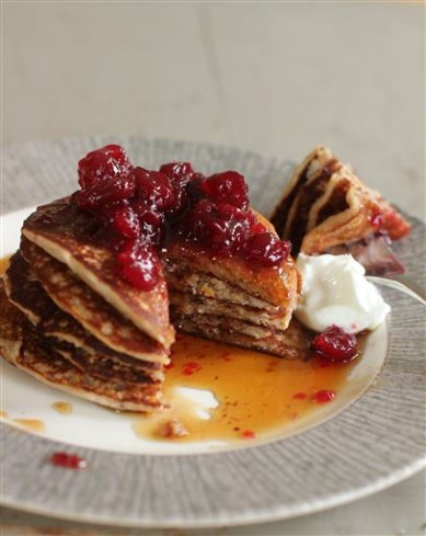 This October 5, 2015 photo shows cranberry sauce, oat and flax pancakes in Concord, NH. Making your own cranberry sauce this holiday is incredibly easy and it allows you to cut the sugar content in half without anyone missing it.  (AP Photo/Matthew Mead)