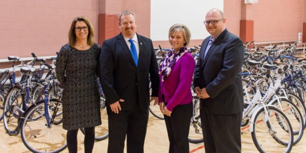 Fifty-nine bikes were donated to the Philadelphia Freedom Valley YMCA Tuesday at the Y's Spring Valley branch by Zagster. Shown here from left to right are: Karen Bliss, vice president of marketing at ASI; Jon Agnew, COO of Philadelphia Freedom Valley YMCA; Meghan Cagliola, district office manager to state Rep. Tom Quigley; and Timothy Ericson, CEO of Zagster. submitted photo