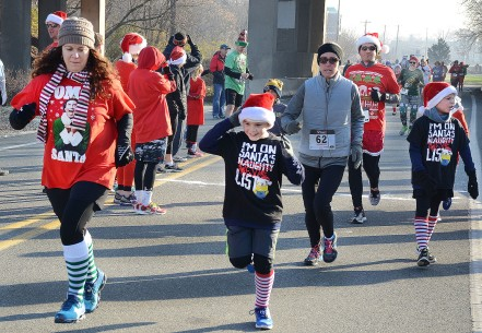 Runners take part in the Pottstown Funky Santa 5K and 3-Person Relay Race....Photo/Tom Kelly III