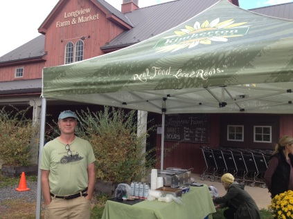 Terry Brett, owner of Kimberton Whole Foods, is pictured at the vendor tent his store operated for The World's Greatest Farmer Showdown and Family Harvest Festival, held at Longview Farm and Market in October 2015. Gary Puleo — digital first media file photo