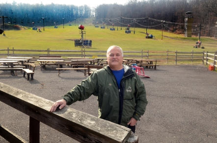 "Geoff Patton--The Reporter Owner Rick Buckman stands near a picnic area Wednesday at Spring Mountain Ski Area in Upper Salford which has not yet opened. ""We just need cold weather,"" Buckman said."