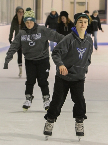 KEVIN HOFFMANÐTHE MERCURY Skaters make their way around the Hill School hockey rink for the annual holiday community skating program which runs daily 12-4 pm through Sat. Jan. 2nd.