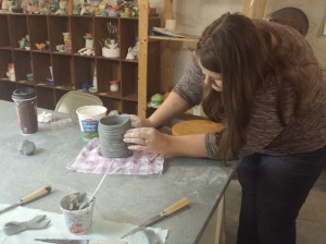 Michilea Patterson - Digital First Media Kathy Deep creates a clay pot during an art workshop in Pottstown. Deep is currently undergoing cancer treatments and said the pot she created represented hope.