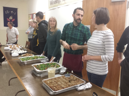 iCreate Cafe owner Ashraf Khalil, one from the right, along with other volunteers prepare to serve vegan foods to the homeless. The meal was served at Christ Episcopal Church Tuesday night. Michilea Patterson — The Mercury