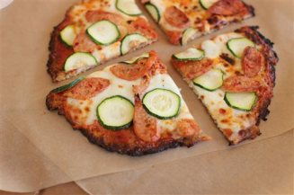 This Nov. 16, 2015 photo shows cauliflower crust pizza in Concord, N.H. Transforming finely chopped cauliflower is so popular, grocers now sell bagged minced cauliflower labeled as ready to use in your favorite pizza crust and mashed potato-like recipes. (AP Photo/Matthew Mead)