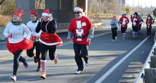 Tom Kelly III — Digital First Media File Photo Runners dressed in festive red costumes participate in the Funky Santa 5K race in Pottstown.
