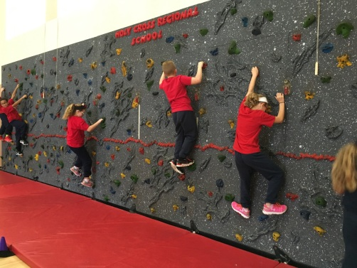 Fifth-grade students at Holy Cross Regional School in Collegeville use a rock climbing wall during physical education class. Students have been using the wall as a fitness activity since the beginning of the school year. Photo courtesy of Jennifer Phillips