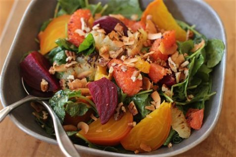 This Nov. 2, 2015 photo shows roasted beet and citrus salad in Concord, NH. Add roasted beats and lightly charred citrus segments with nicely dressed greens for a robust salad. (AP Photo/Matthew Mead)