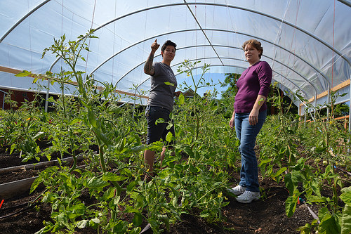 Urban farmer Stacey Givens and Kim Galland from NRCS talk about the benefits of high tunnel at the Side Yard Farm.