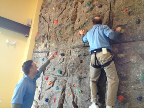 """Recreation supervisor Kevin Letrinko (left) points out a feature of the Rockwall to certified instructor Scott Weichel in the middle of his climb at Upper Providence Township Recreation Center's """"Winter Wonderland of Wellness"""" event on Sunday. Gary puleo — THE TIMES HERALD"""