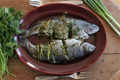 This Nov. 16, 2015 photo shows baked whole fish in Concord, N.H. This dish is from a recipe by Sara Moulton. (AP Photo/Matthew Mead)