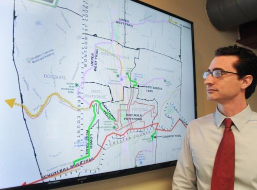 John Strickler - Digital First MediaJustin Keller looks over the trails map.