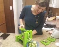 Registered dietitian Jessica Garnett uses a veggie spiralizer to turn a zucchini into noodles.