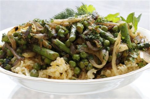 This March 7, 2016 photo shows spring vegetable pilau with fennel and asparagus in Concord, N.H. The combination of rice packed with spiced fennel, onions and garlic cooked slowly until soft and finished with still-crisp asparagus and peas makes for a perfect spring dish. (AP Photo/J.M. Hirsch)