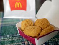 FILE - In this March 4, 2015 file photo, an order of McDonald's Chicken McNuggets is displayed for a photo in Olmsted Falls, Ohio. McDonald's is testing Chicken McNuggets with no artificial preservatives as it works to revive its U.S. business. The world's biggest hamburger chain says it began testing the new recipe in about 140 stores in Oregon and Washington in March 2016.  (AP Photo/Mark Duncan)