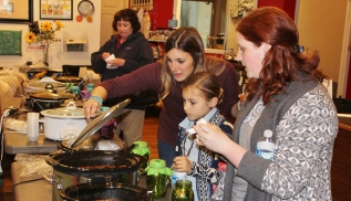 People make their way down the line to taste several different dishes a chili cook-off at Grumpy's Restaurant in Pottstown. The tasting was part of the Pottstown farmers market opening day which also celebrated Cinco De Mayo.