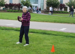 Joyce Schroeder, 93, gets in position to participate in a football throw as part of the 2016 Montgomery County Senior Games at the Blue Bell MCCC campus May 13. Schroeder has been participating in the games for more than 30 years.