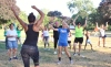 People raise their hands as they dance during a free outdoor Zumba class at Memorial Park in Pottstown Wednesday June 29, 2016. The event was a collaborative effort between the Pottstown YMCA, Fit for Life and the Pottstown Park & Recreation.