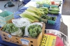 Corn, hot peppers, zucchini and tomatoes are laid out on a table for purchase during last week's outdoor farmers market in Pottstown along High Street. Steer Vegetables & Herbs is one of the market vendors selling fresh produce.
