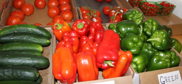 Peppers and other vegetables are on display inside of Daniel's Produce and Dairy Store during the outdoor Pottstown farmers market along E. High Street last week.