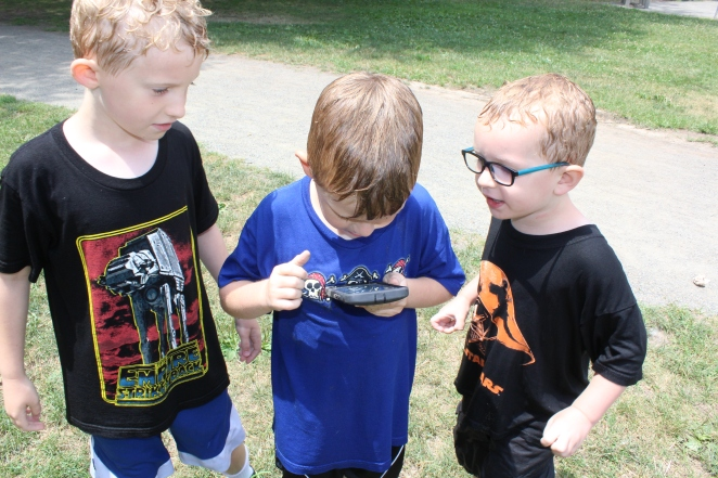 Six-year-old William Rose, center, plays Pokemon Go with his brothers eight-year-old Christopher, on the left, and four-year-old Thomas, on the right.