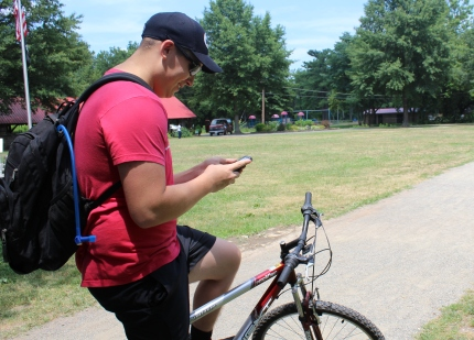 Randall Knight Jr. rides his bike about five miles daily and does so while playing the popular game app Pokemon Go. Michilea Patterson — Digital First Media