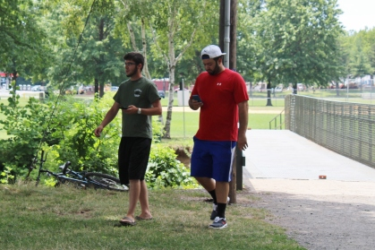 Two people walk at Memorial Park in Pottstown while playing Pokemon Go. The game app has become extremely popular since its launch. Michilea Patterson — Digital First Media