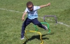 Four-year-old Gavin Harris jumps over bars as part of a kids obstacle course during the combined Pottstown Celebrates Young Children event and the YMCA Healthy Kids Day. Digital First Media File Photo