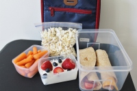 A healthful packed school lunch should include calcium-rich item, a whole grain and a vegetable or a fruit.
