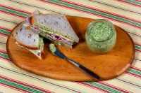 This Aug. 4, 2016 photo shows a ham and cheese sandwich with green spread, styled by Sarah Abrams, displayed at the Institute of Culinary Education in New York. (AP Photo/Richard Drew)