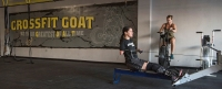 In a Sept. 26, 2016 photo, Marine veteran Cindy Martinez warms up on a rowing machine ahead of a weightlifting workout at the Crossfit Goat gym in Dacula, Georgia. Martinez lost three limbs and part of the fingers on her remaining arm after getting a flesh-eating bacteria in 2015 and nearly dying. (AP Photo/Lisa Marie Pane)