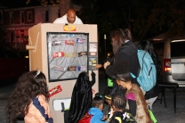 Ken Trusty, of the Pottstown YMCA, dresses as a candy machine with real candy bars inside during a safe trick-or-treating event in Pottstown. The event was called Light in the Night Safe Zone and kids could also visit parked cars for trunk-or-treating.
